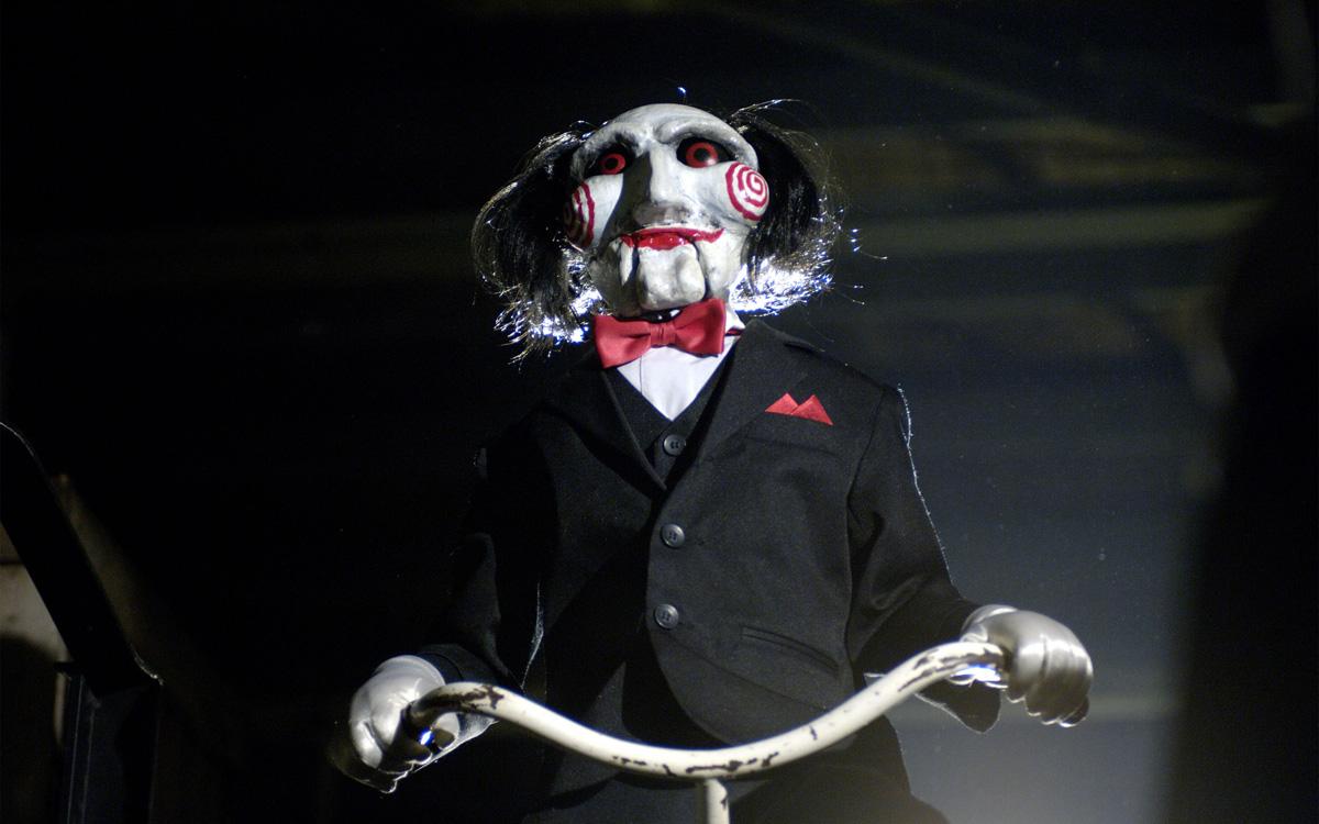 Ужасная кукла-марионетка Пилы, через которую маньяк объявлял задания жертвам